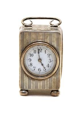 Lot 14 - A silver miniature carriage clock
