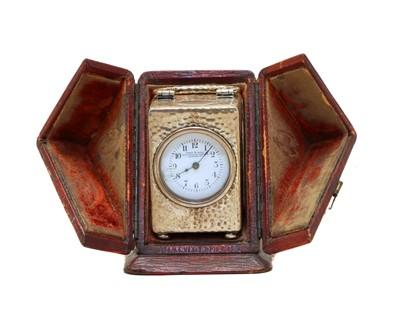 Lot 13 - An Edwardian silver miniature carriage clock