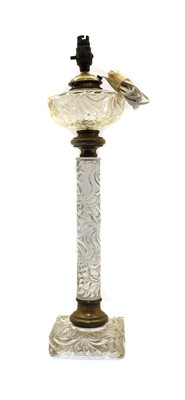 Lot 92 - A late 19th century heavy moulded glass and brass oil lamp