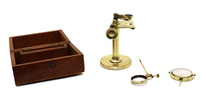 Lot 65 - A mahogany cased lacquered brass microscope