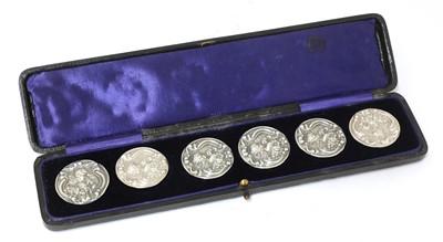 Lot 27 - A cased set of six Art Nouveau silver buttons