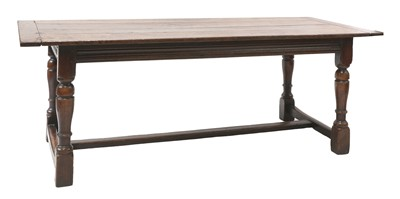 Lot 654 - An oak refectory table