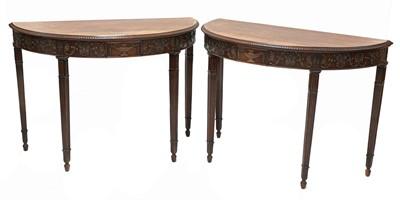 Lot 465 - A pair of Adam Revival mahogany demilune console tables