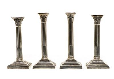 Lot 1 - Two pairs of similar Victorian silver pillar candlesticks