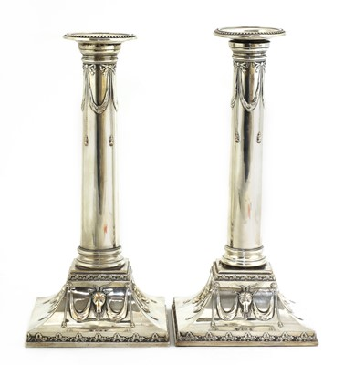 Lot 497 - A pair of Edwardian silver-plated neoclassical candlesticks