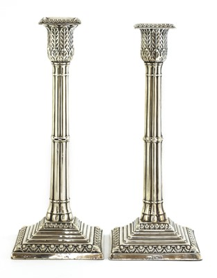 Lot 83 - A pair of silver cluster column table candlesticks