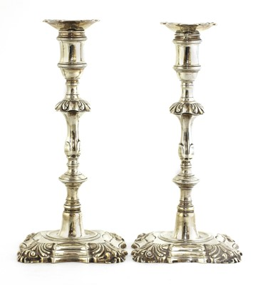 Lot 504 - A pair of cast silver table candlesticks
