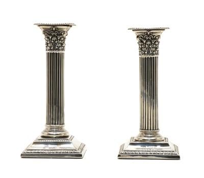Lot 39 - A pair of modern dwarf silver pillar candlesticks