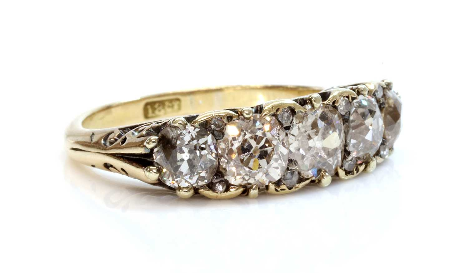 Lot 39 - A five stone diamond carved head ring