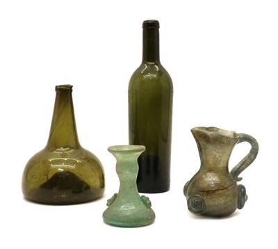 Lot 105 - An 18th century green glass bottle