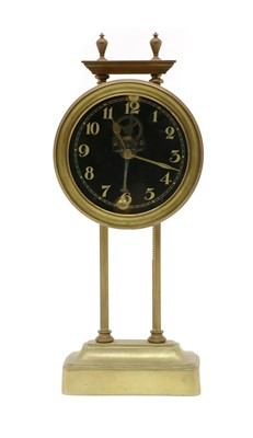 Lot 117 - A brass portico clock