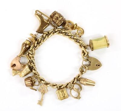Lot 97 - A gold charm bracelet