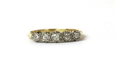 Lot 48 - A gold five stone diamond ring