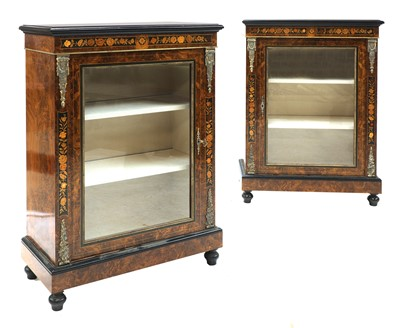 Lot 182 - A pair of Victorian figured walnut pier cabinets