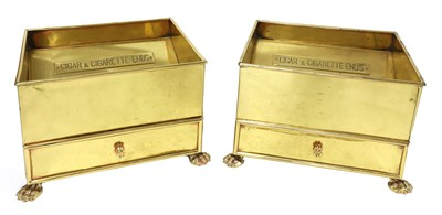 Lot 107 - A pair of large brass ashtrays