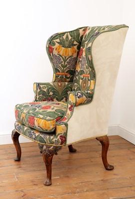 Lot 670 - A Queen Anne wingback armchair