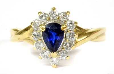 Lot 124 - A gold sapphire and diamond cluster ring