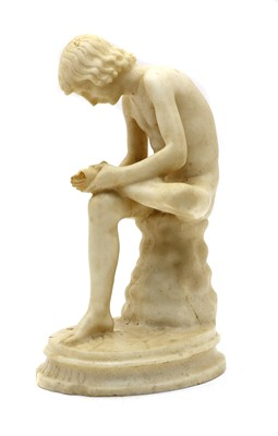 Lot 66 - A marble sculpture of Spinario