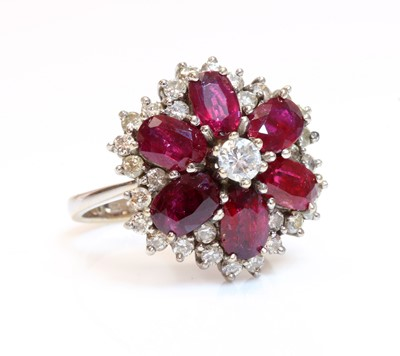 Lot 179 - A diamond and ruby cluster ring