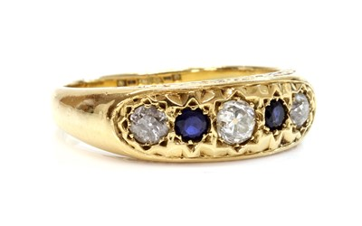 Lot 136 - A gold five stone diamond and sapphire ring