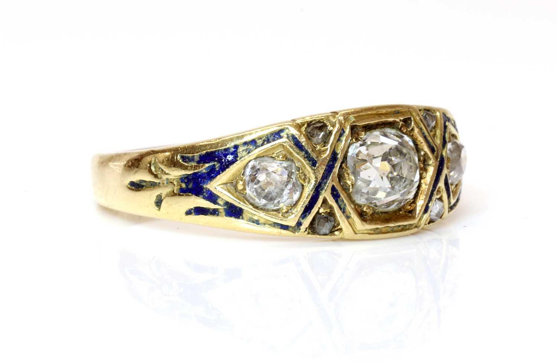 Lot 40 - A Victorian three stone graduated diamond and enamel ring, c.1860