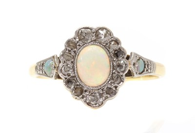 Lot 1040 - A gold opal and diamond cluster ring