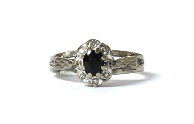 Lot 125 - An 18ct white gold sapphire and diamond cluster ring