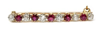 Lot 45 - A ruby and diamond two colour bar brooch