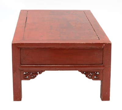 Lot 73 - A Chinese low red-lacquered coffee table