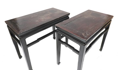 Lot 489 - A pair of Chinese ebonised and parcel-gilt hardwood low tables
