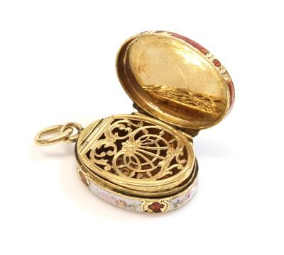 Lot 25 - A miniature gold oval locket form vinaigrette