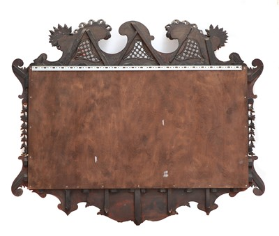 Lot 492 - A large George II-style mahogany and parcel-gilt mirror