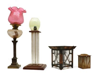 Lot 97 - A Duplex brass and cranberry glass oil lamp