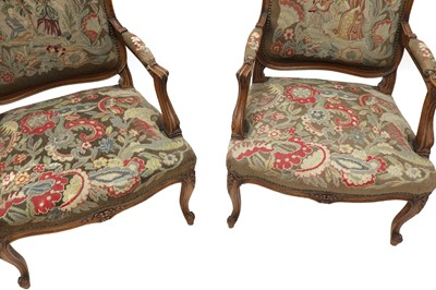 Lot 486 - A pair of French Louis XV-style beech fauteuils
