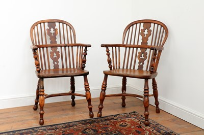 Lot 428 - A pair of yew and elm low hoop back Windsor chairs
