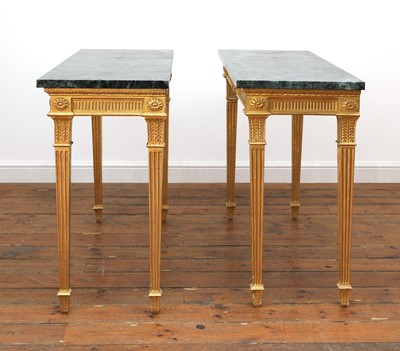 Lot 44 - A pair of giltwood console tables in the manner of Robert Adam