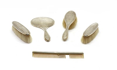 Lot 45 - A four piece silver dressing set