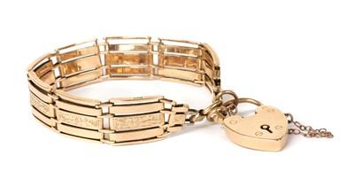 Lot 1110 - A gold five row gate bracelet