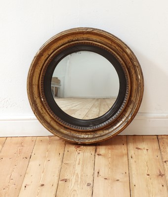 Lot 459 - A Regency gilt-framed convex wall mirror