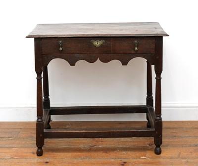 Lot 519 - An oak side table