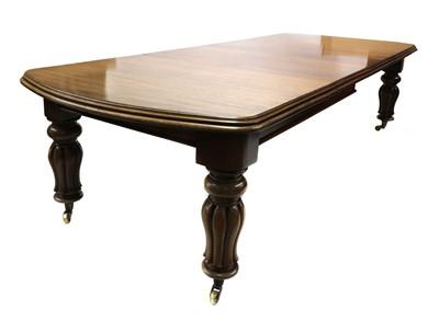 Lot 111 - A Victorian walnut extending dining table