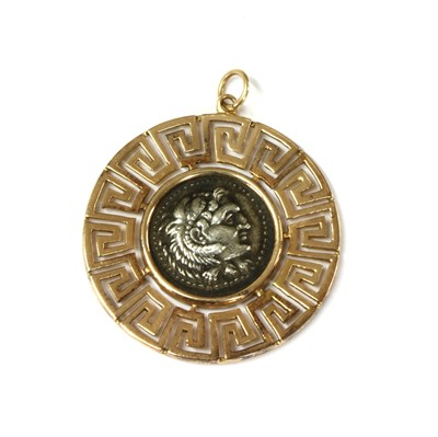 Lot 87 - A gold and silver pendant