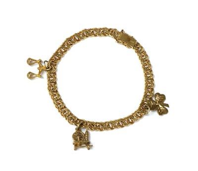 Lot 99 - A gold charm bracelet