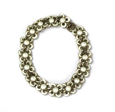 Lot 41 - A Norwegian silver gilt and guilloché quatrefoil bracelet, by David Andersen
