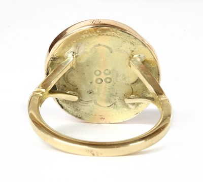 Lot 26 - A gold single stone coral ring