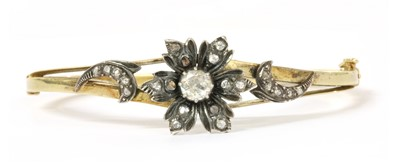 Lot 8 - A silver and gold diamond set bangle