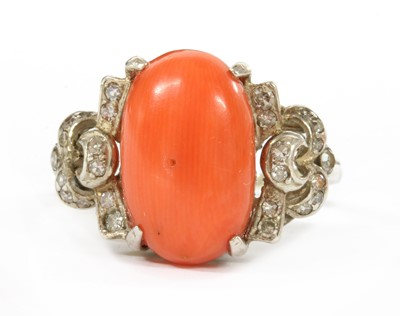 Lot 27 - A white gold coral and diamond ring