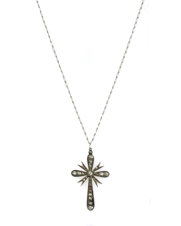 Lot 81 - A silver diamond set cross