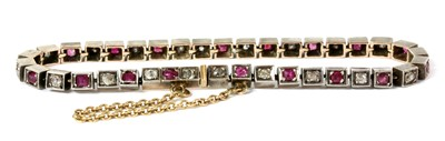 Lot 7 - A French silver and gold, ruby and diamond line bracelet