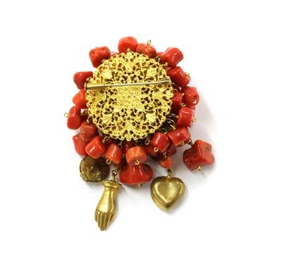 Lot 30 - A gilt metal coral brooch
